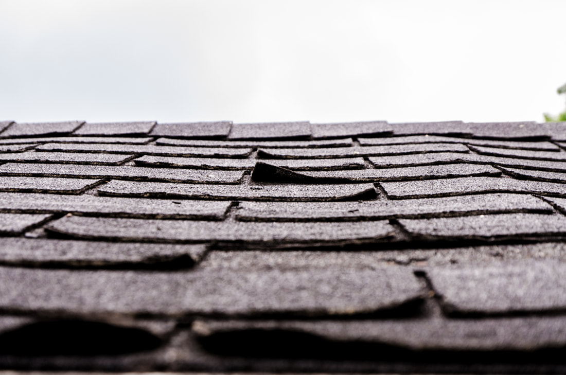 lifted shingles on old roof